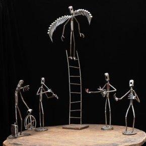 sculptures métal personnages Mouche